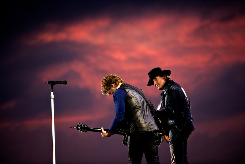 . July 24, 2011 - Bon Jovi members Jon Bon Jovi, left, and Richie Sambora perform on stage at Zeebrugge Beach in Bruges, BE on July 24, 2011.  (Photo credit: David Bergman / Bon Jovi)