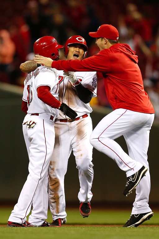 . CINCINNATI, OH - SEPTEMBER 23:  Shin-Soo Choo #17 of the Cincinnati Reds is congratulated by teammates after hitting a walk-off double to defeat the New York Mets 3-2 in the 10th inning at Great American Ball Park on September 23, 2013 in Cincinnati, Ohio. (Photo by Kirk Irwin/Getty Images)
