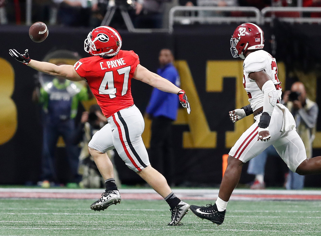 . Georgia\'s Christian Payne can\'t catch a pass during the first half of the NCAA college football playoff championship game against Alabama Monday, Jan. 8, 2018, in Atlanta. (AP Photo/David Goldman)