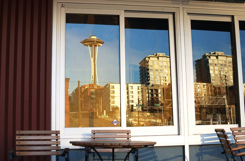#4194 - Space Needle Reflection Walking by this window, I suddenly realized that the reflection of the space needle and surrounding buildings was more interesting that the direct view.