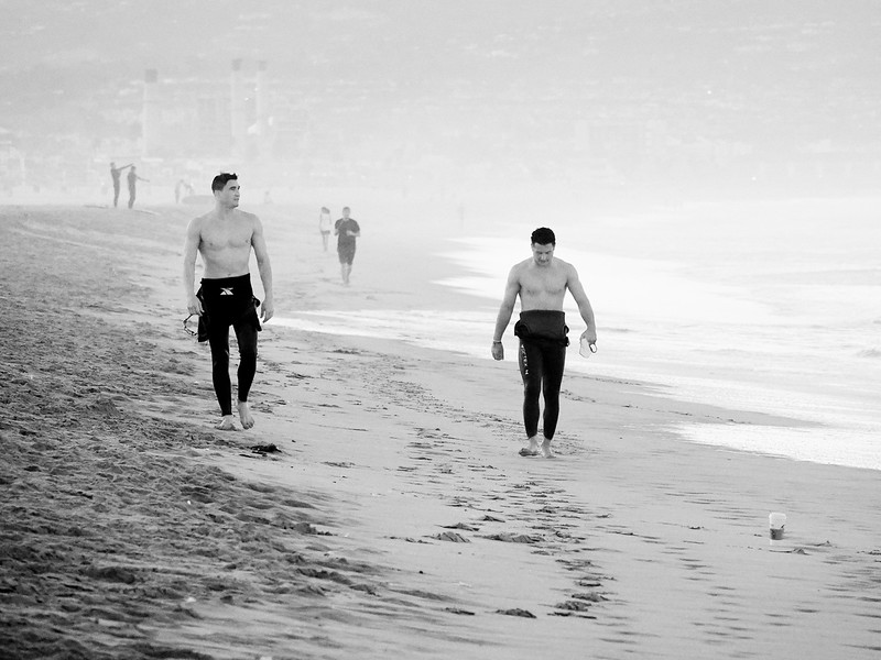 Two surfers, post fun in the water, in Manhattan Beach