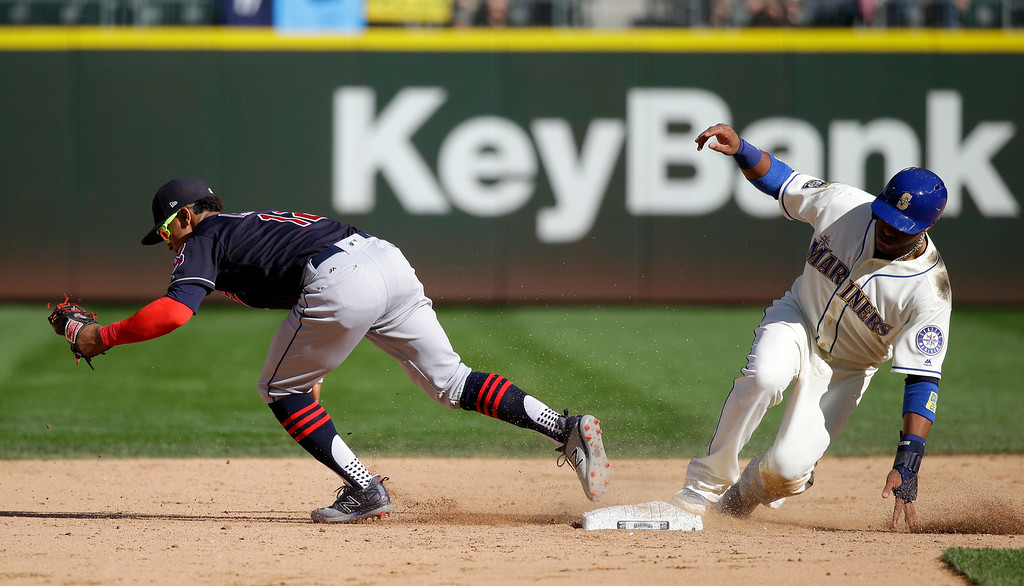 . Seattle Mariners\' Robinson Cano, right, is forced at second by Cleveland Indians shortstop Francisco Lindor, left, in the eighth inning of a baseball game, Sunday, Sept. 24, 2017, in Seattle. The Indians won 4-2. (AP Photo/Ted S. Warren)
