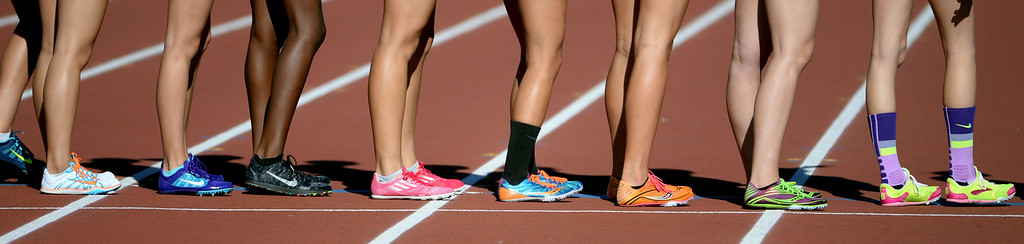 . Athletes prepare for the 4x800 meter relay invitational race during the Arcadia Invitational track and field meet at Arcadia High School in Arcadia, Calif., on Friday, April 11, 2014.  (Keith Birmingham Pasadena Star-News)