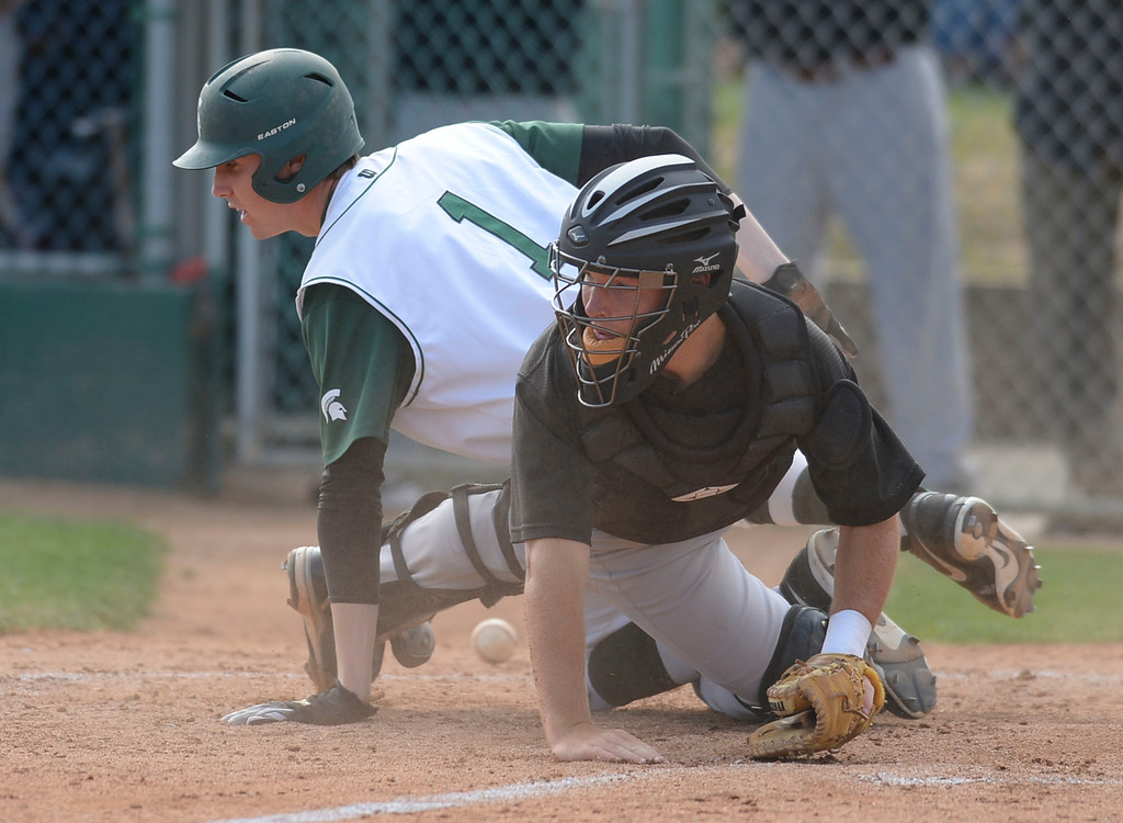 . South\'s Gunner Johnson (1) slides into home as the ball gets away from Estancia catcher Jackson Letterman (17) in a first-round CIF SS Division IV baseball game Friday in Torrance. South won 7-2. 20130517 Photo by Steve McCrank / Staff Photographer