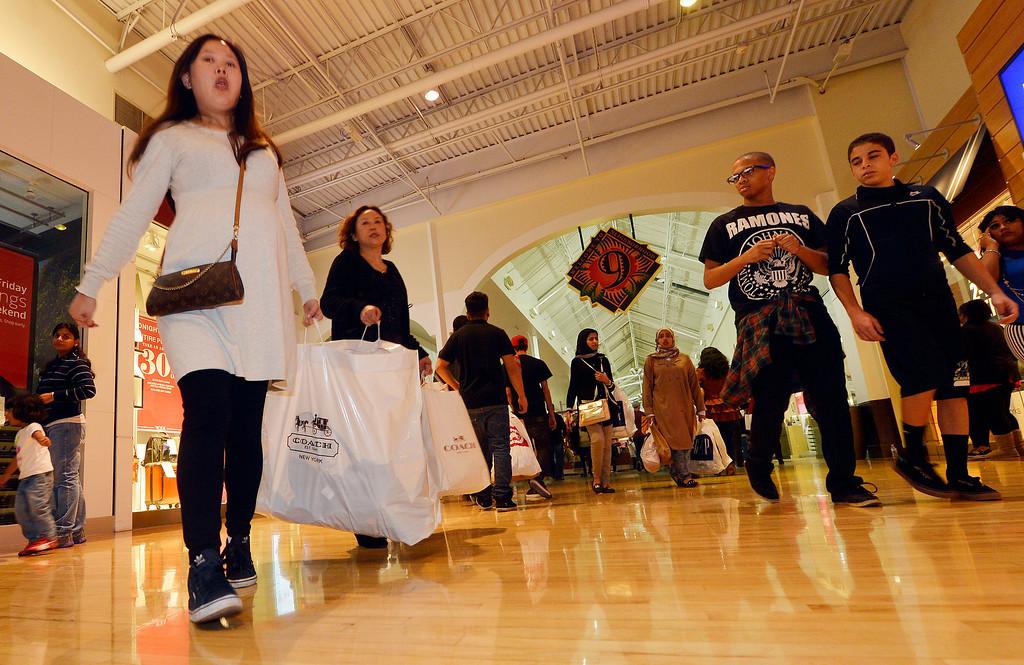 . Thousands of holiday shoppers descend on the Ontario Mills Thursday night November 28, 2013 for the malls 8p.m. opening. (Will Lester/Inland Valley Daily Bulletin)
