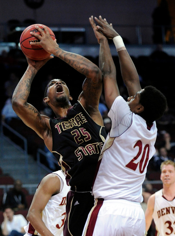 . Texas State\'s Joel Wright (25) shoots against Denver\'s Royce O\'Neale (20) during the fist half of a Western Athletic Conference tournament NCAA college basketball game on Thursday, March 14, 2013, in Las Vegas. Texas State won 72-68. (AP Photo/David Becker)