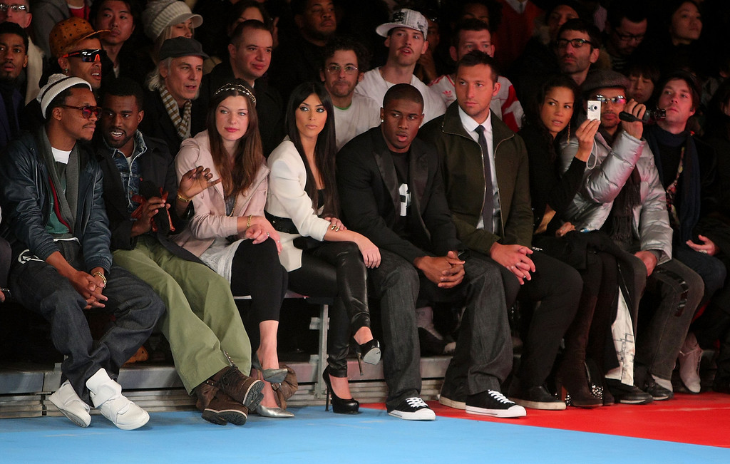 . NEW YORK - FEBRUARY 15:  (L-R) Lupe Fiasco, Kanye West, Milla Jovovich, Kim Kardashian, Reggie Bush, Ian Thorpe, Veronica Webb and Rufus Wainwright attend the Y-3 Autumn/Winter 2009-10 fashion show during Mercedes-Benz Fashion Week at Pier 40 on February 15, 2009 in New York City.  (Photo by Andrew H. Walker/Getty Images for Y-3) *** Local Caption *** Lupe Fiasco;Kanye West;Milla Jovovich;Kim Kardashian;Reggie Bush;Ian Thorpe;Veronica Webb;Rufus Wainwright