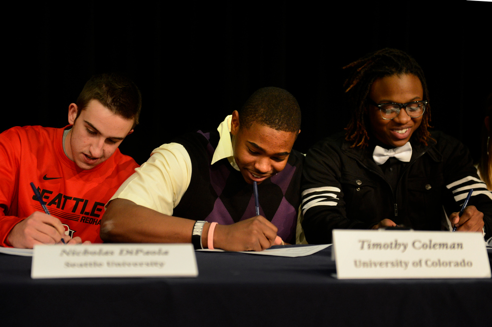 . College signing day for Tim Coleman (center) who signed his letter of intent to go to Colorado University is flanked by Nick DiPaola, baseball at Seattle University (left) and Damien Douglas, football at Mesa State at Mullen High School in the Rilko Event Center on Mullen campus February 6, 2013 Denver, Colorado. (Photo By Joe Amon/The Denver Post)