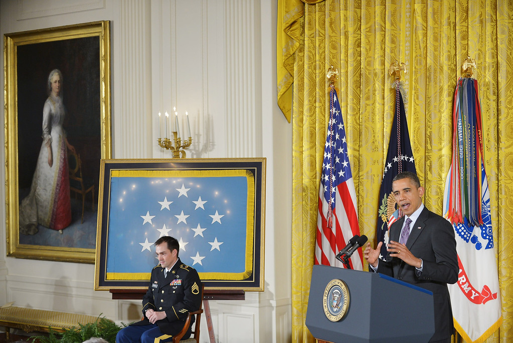 . US President Barack Obama speaks before presenting  Clinton Romesha (L), former active duty Army staff sergeant, with the Medal of Honor during a ceremony in the East Room of the White House on February 11, 2013 in Washington, DC.  AFP PHOTO/Mandel NGAN/AFP/Getty Images
