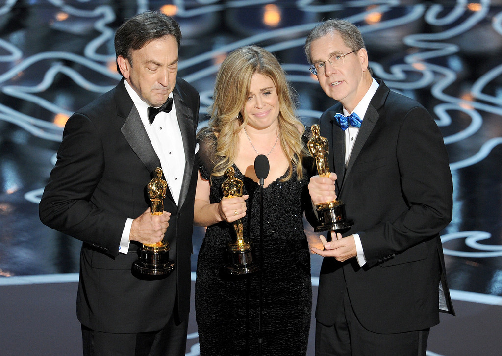 . (L-R) Producer Peter Del Vecho, directors Jennifer Lee and Chris Buck accept the Best Animated Feature Film award for \'Frozen\' onstage during the Oscars at the Dolby Theatre on March 2, 2014 in Hollywood, California.  (Photo by Kevin Winter/Getty Images)