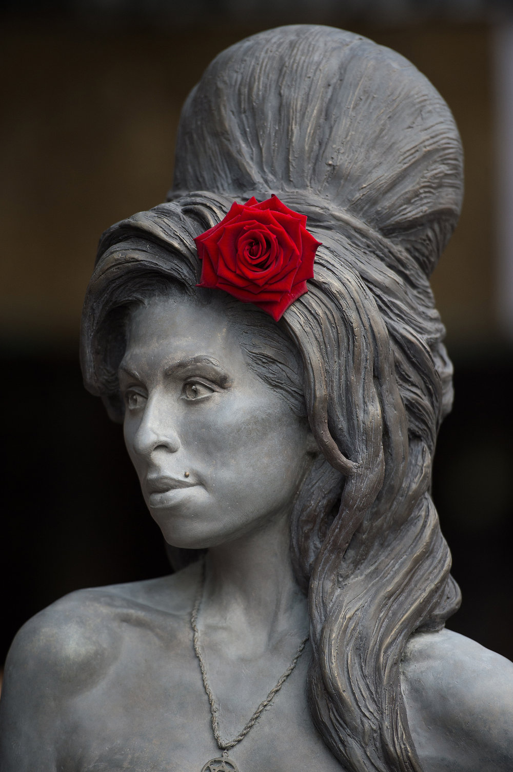 . A new statue of the late singer Amy Winehouse after it was unveiled in Camden\'s Stables Market, in London, England, Sunday, Sept. 14, 2014. Three years after her death the unveiling coincides with what would have been her 31st birthday. (AP Photo/Tim Ireland)