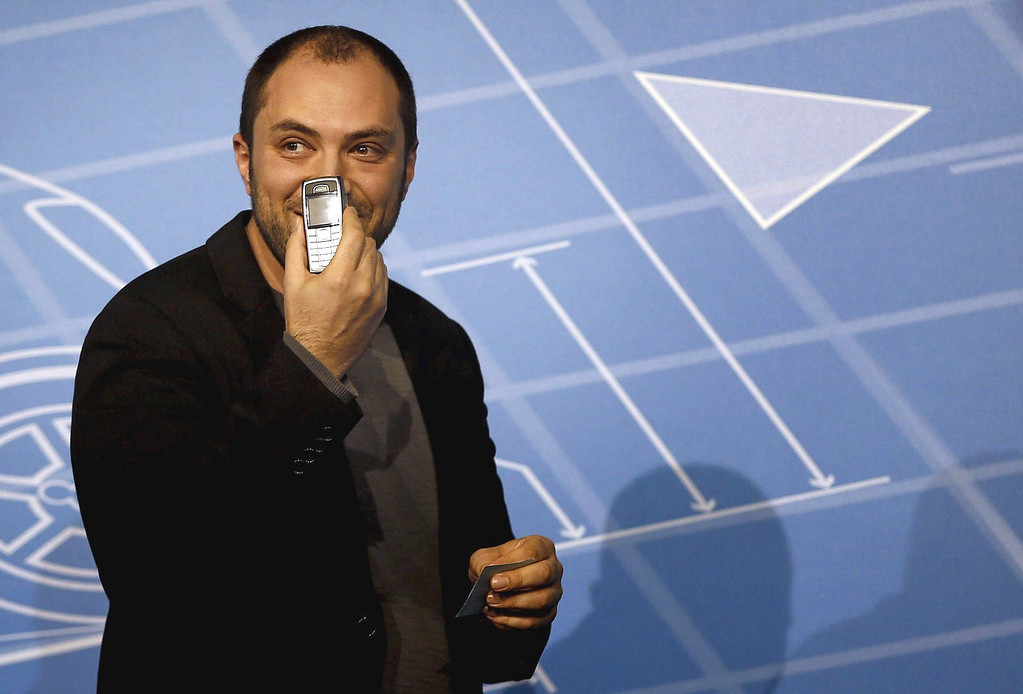 . WhatsApp message app\'s co-founder, Jan Koum, displays his personal mobile phone as he takes part in a debate held in the sidelines of Mobile World Congress in Barcelona, northeastern Spain, 24 February 2014. Koum announced WhatsApp will introduce voice calls in the year\'s second quarter. Mobile World Congress, the world\'s most important exhibition in the mobile industry, will gather from 24 to 27 February around 1,700 exhibitors from 205 countries from around the world.  EPA/ALBERTO ESTEVEZ