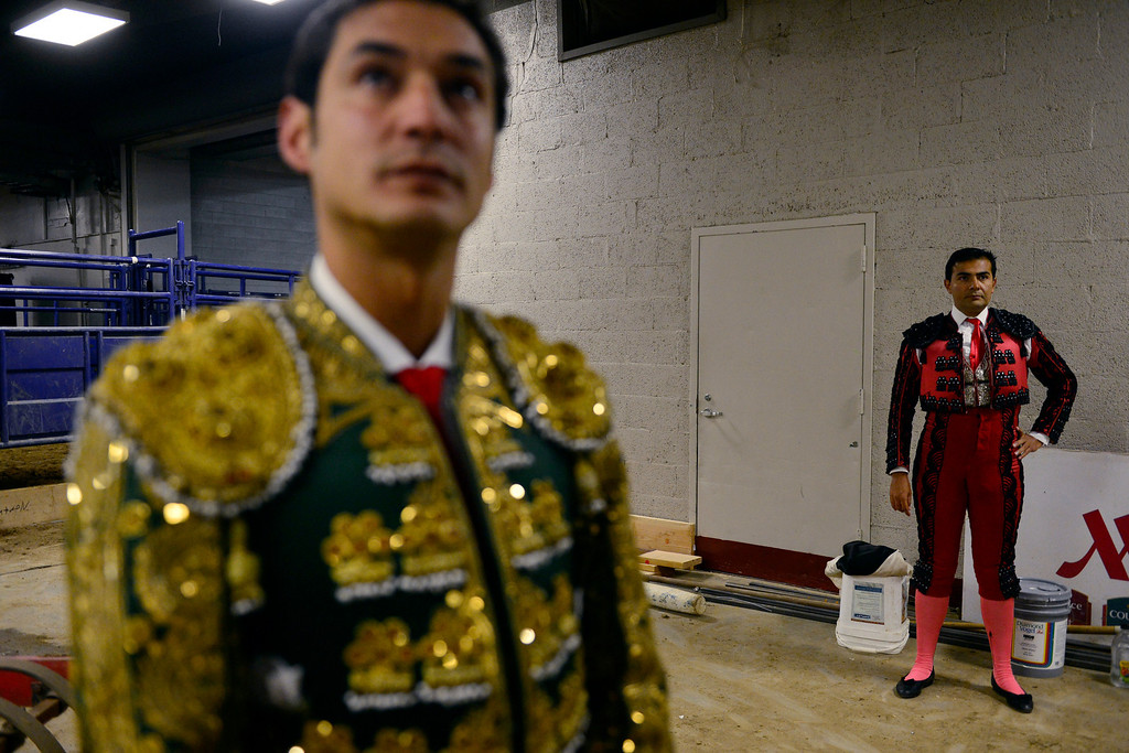 . Matadors Alfredo Gutierrez and Paco Munoz prepare during National Western Stock Show\'s Mexican Rodeo Extravaganza at the Denver Coliseum on Sunday, Jan. 13, 2013. AAron Ontiveroz, The Denver Post