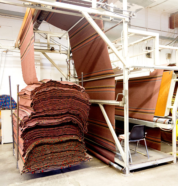 Cutting blankets from woven stock