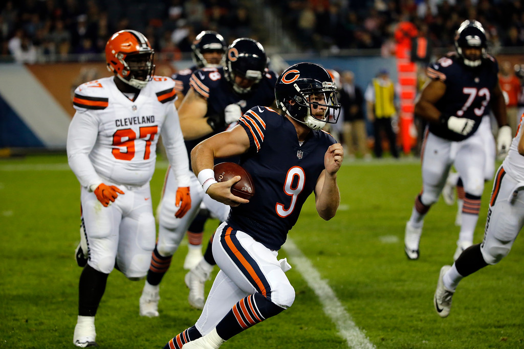 . Chicago Bears quarterback Connor Shaw (9) runs during the first half of an NFL preseason football game against the Cleveland Browns, Thursday, Aug. 31, 2017, in Chicago. (AP Photo/Charles Rex Arbogast)