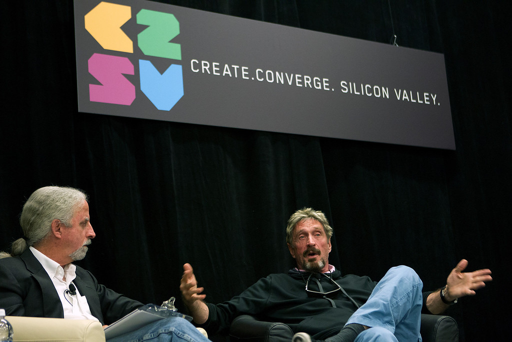 """. John McAfee, right, speaks with Dan Holden at the \""""Fireside Chat with John McAfee\"""" during the C2SV Technology Conference + Music Festival at the McEnery Convention Center in San Jose, Calif., on Saturday, Sept. 28, 2013.   (LiPo Ching/Bay Area News Group)"""