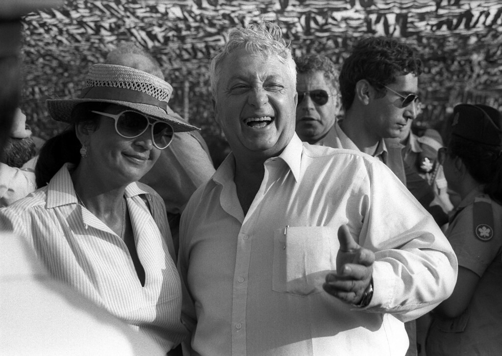 . In this handout from the Israeli Governmental Press Office, Defense Minister Ariel Sharon and his wife Lily attend a pilots graduation parade and aerial display July 15, 1982 at Hatzerim Air Force Base, Israel. (Photo by Rimon Baruch/GPO via Getty Images)