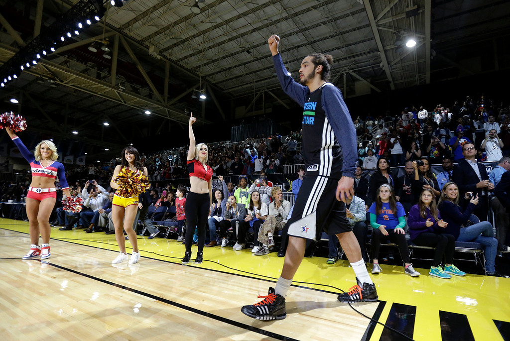 . Team East\'s Joakim Noah, of the Chicago Bulls, is introduced at practice during NBA All-Star basketball weekend festivities, in New Orleans, Saturday, Feb. 15, 2014. (AP Photo/Gerald Herbert)