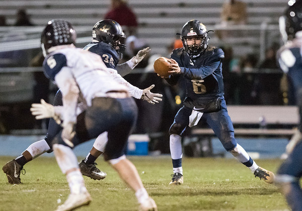 11/21/18 Wesley Bunnell | Staff Newington vs Wethersfield on Wednesday night at Newington High School. QB Nicholas Pestrichello (6) with the hand off.