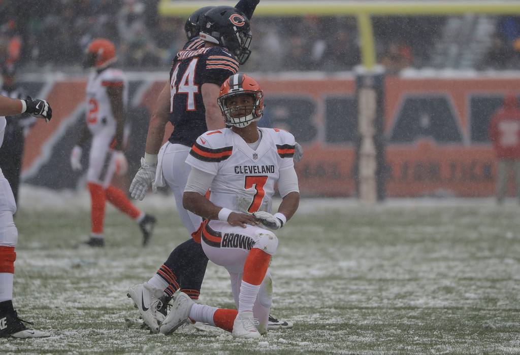 . Cleveland Browns quarterback DeShone Kizer (7) watches from a knee after a play against the Cleveland Browns during an NFL football game in Chicago, Sunday, Dec. 24, 2017. (AP Photo/Nam Y. Huh)