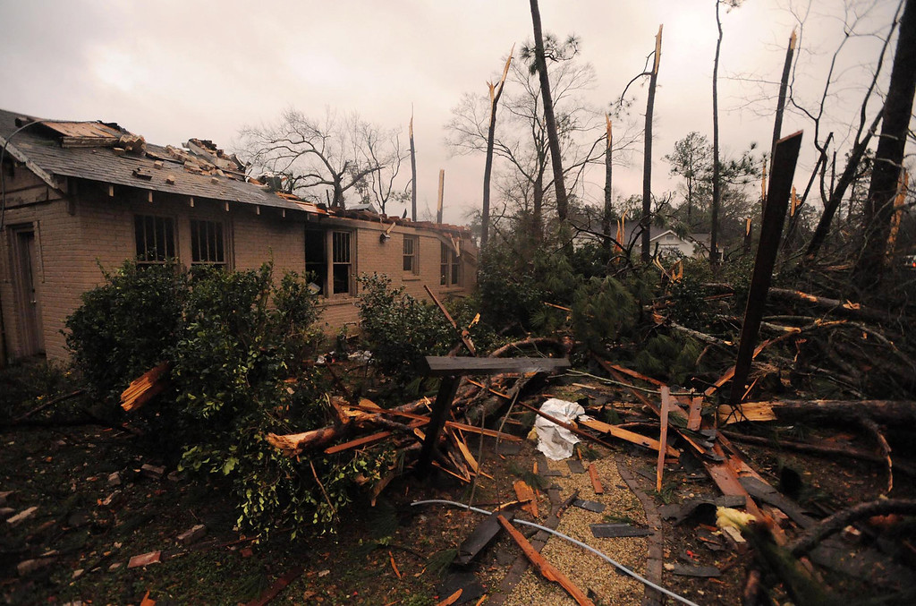 . A house is damaged in Hattiesburg Miss. after a tornado passed through the city Sunday, Feb. 10, 2013. (AP Photo/Hattiesburg American, Ryan Moore)
