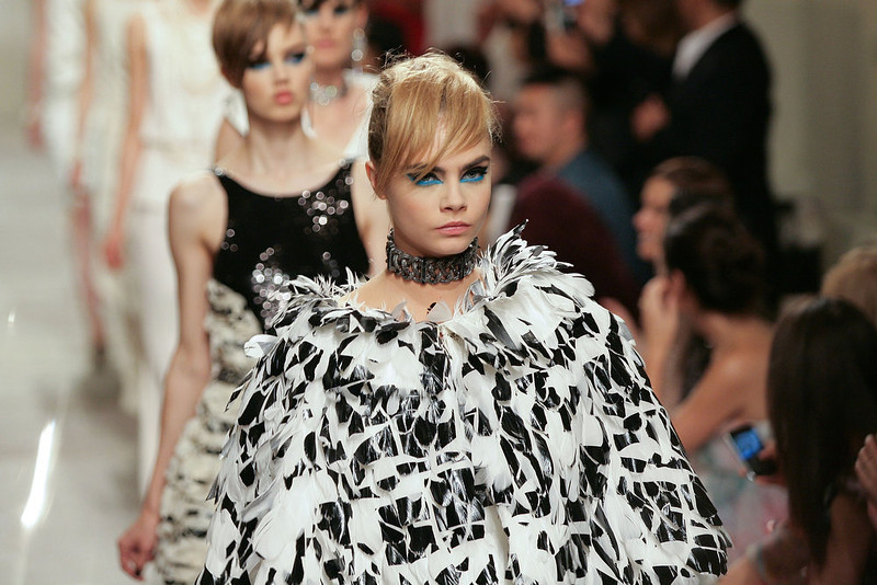 . Cara Delevingne walks the runway during Chanel Cruise 2013/14 Collection show on May 9, 2013 in Singapore.  (Photo by Rahman Roslan/Getty Images)