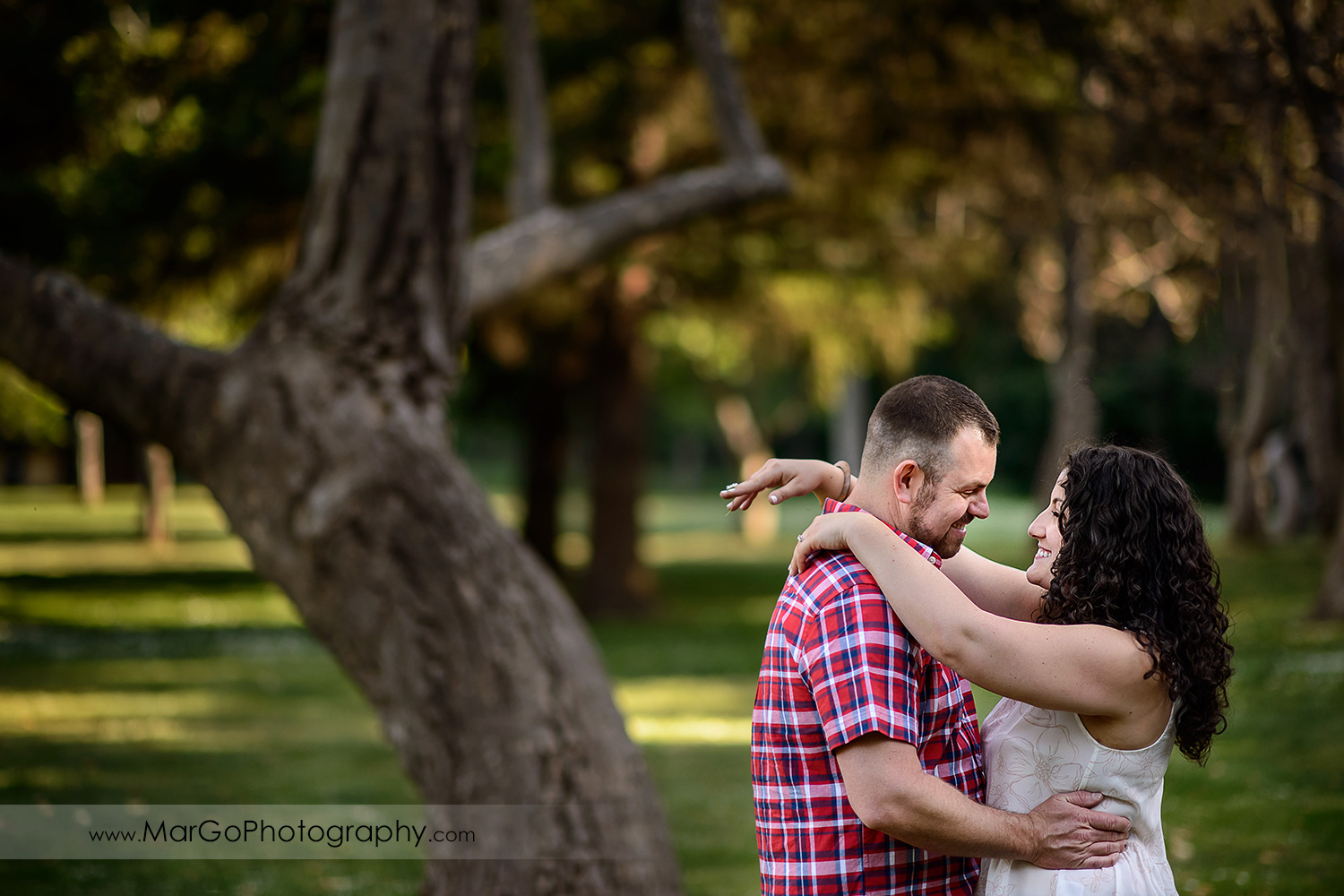 engaged couple dancing at Sanborn County Park
