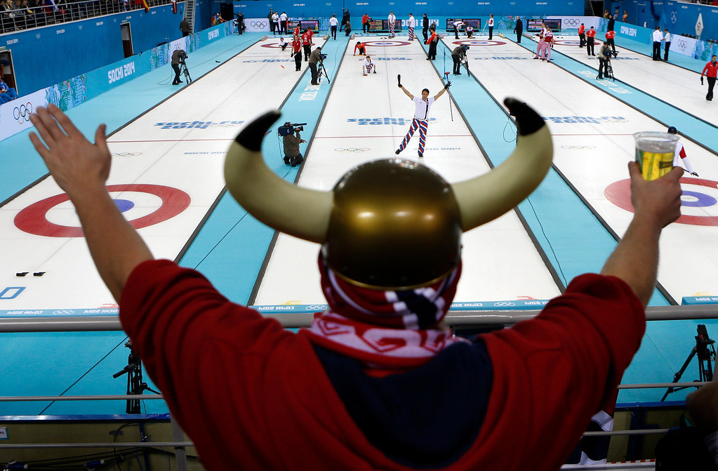. Norway\'s skip Thomas Ulsrud acknowledges the cheers of fan Rune Eikeland during men\'s curling competition against China at the 2014 Winter Olympics, Friday, Feb. 14, 2014, in Sochi, Russia. (AP Photo/Robert F. Bukaty)