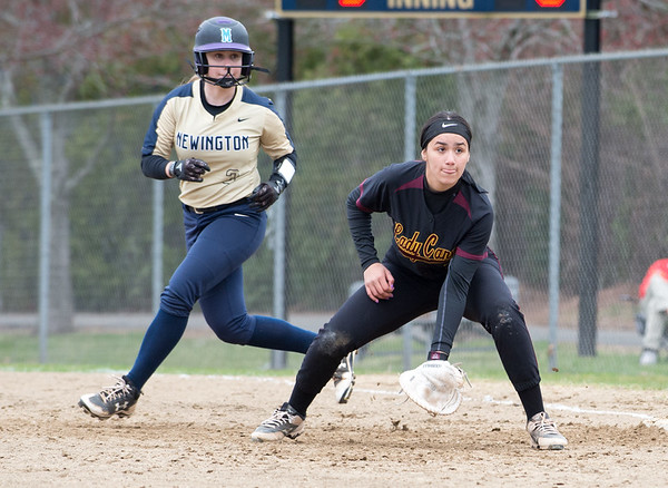 04/11/19 Wesley Bunnell | Staff New Britain softball defeated Newington on the road 4-1 on Thursday afternoon. Val Hernandez (7) holds on Newington's Madelyn Ellis (3).