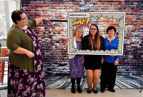 10/11/2019 Mike Orazzi | StaffrJenn Greiner and Kayla Pellrine (third from the left) with Annette D. and Elisa D. at the photo booth during the Bristol ARC gala held at the DoubleTree Hotel in Bristol on Friday evening.