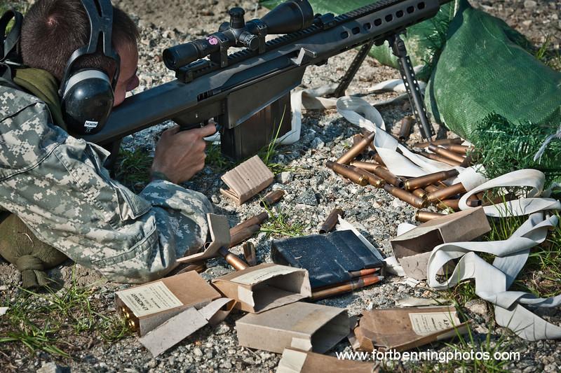 22 APR 2011 (FORT BENNING, GA) Students in week four of Sniper School, fire M107 .50 caliber long range sniper rifles. Coolidge Range, Harmony Church. Photo by Susanna Avery-Lynch - susanna.lynch@us.army.mil