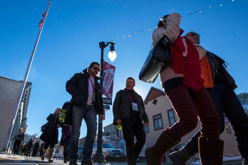 Description of . Pedestrians walk down Main St. past Sundance Film Festival signs on the first day of the festival in Park City, Utah, January 17, 2013. REUTERS/Lucas Jackson