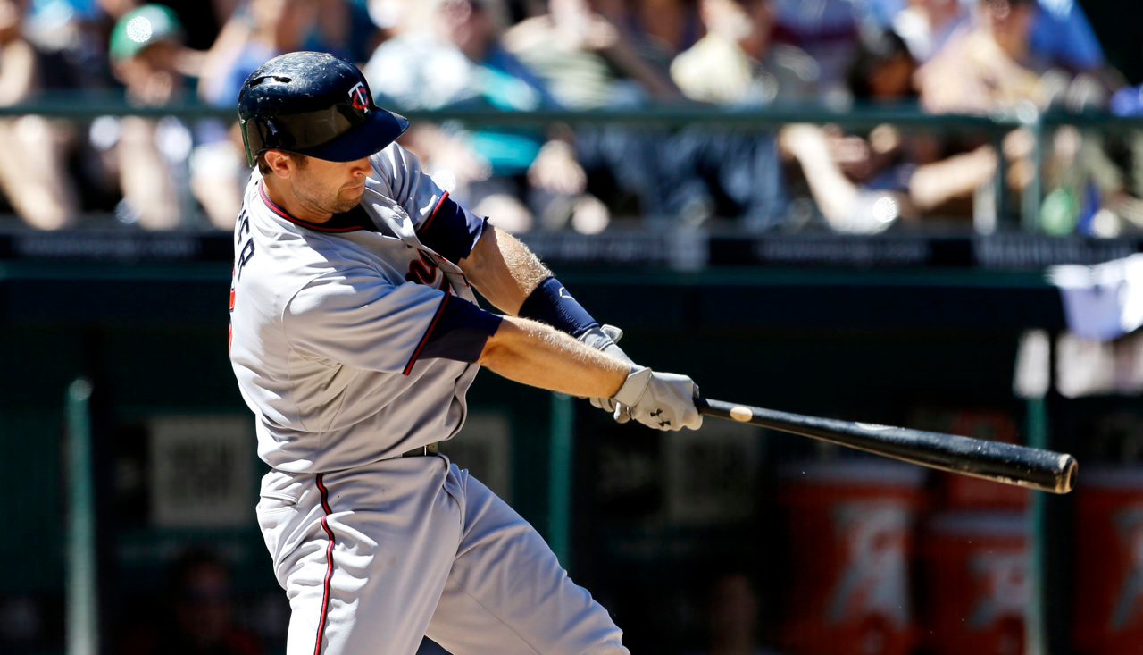 . Minnesota Twins\' Brian Dozier homers against the Seattle Mariners in the seventh inning. (AP Photo/Elaine Thompson)