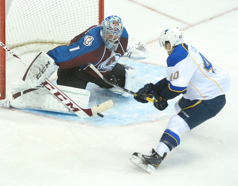 . Colorado goaltender Semyon Varlamov stuffed St. Louis center Maxim Lapierre (4) on a a breakaway in the second period. The St. Louis Blues defeated the Colorado Avalanche 2-1 at the Pepsi Center Saturday afternoon, March 8, 2014 in Denver, Colorado. (Photo by Karl Gehring/The Denver Post)