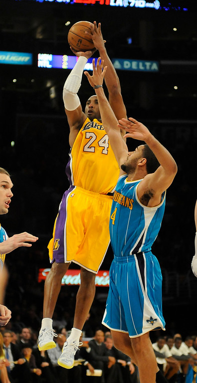 . Lakers#24 Kobe Bryant shoots over Hornets#4 Xavier Henry in the 4th quarter. The Lakers defeated New Orleans Hornets 104-96 in a game played at Staples Center in Los Angeles, CA 4/9/2013(John McCoy/Staff Photographer