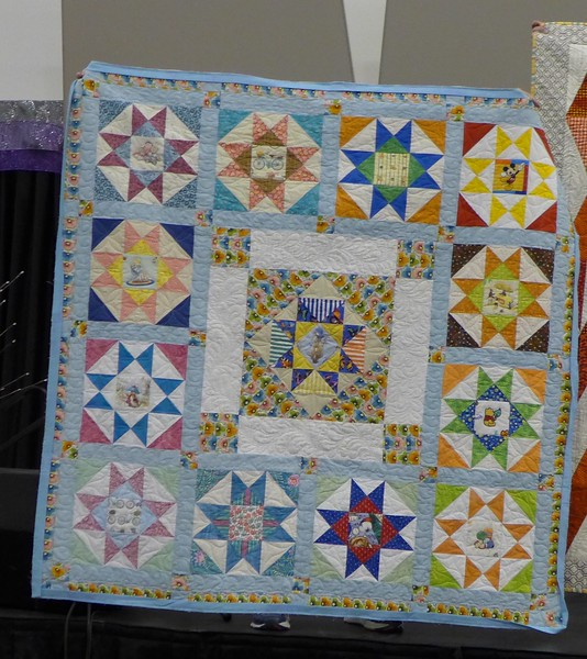 Bonnie Buss told us about the Foster Friday group making this quilt for Mary Jo.
