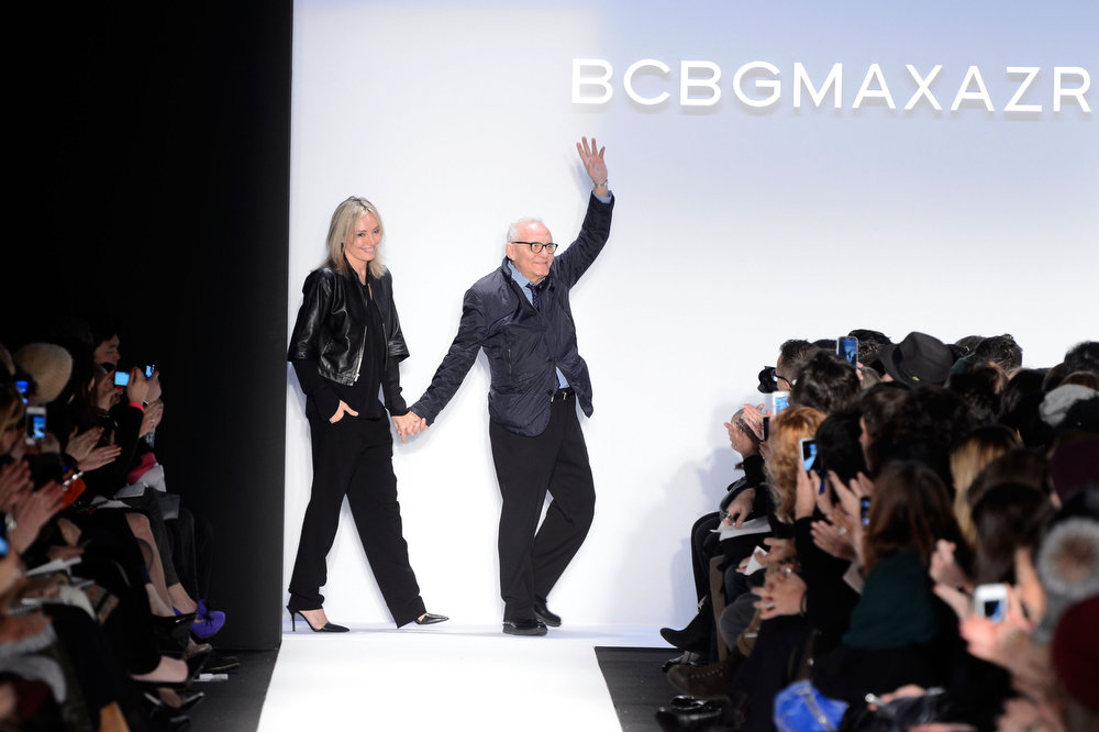 . Lubov Azria and designer Max Azria walk the runway at the BCBGMAXAZRIA Fall 2013 fashion show during Mercedes-Benz Fashion Week at The Theatre at Lincoln Center on February 7, 2013 in New York City.  (Photo by Frazer Harrison/Getty Images for Mercedes-Benz Fashion Week)