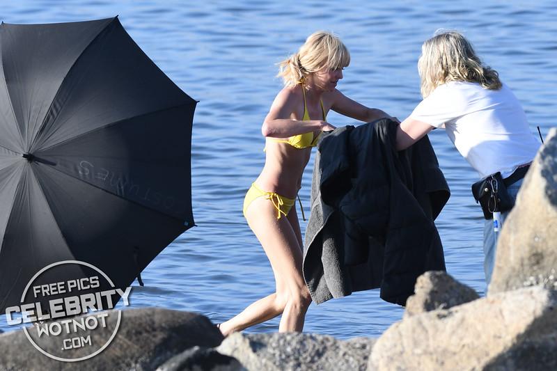 Anna Faris Hugs A Topless Eugenio Derbez In A Yellow Bikini!