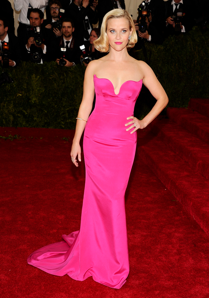 """. Reese Witherspoon attends The Metropolitan Museum of Art\'s Costume Institute benefit gala celebrating \""""Charles James: Beyond Fashion\"""" on Monday, May 5, 2014, in New York. (Photo by Charles Sykes/Invision/AP)"""