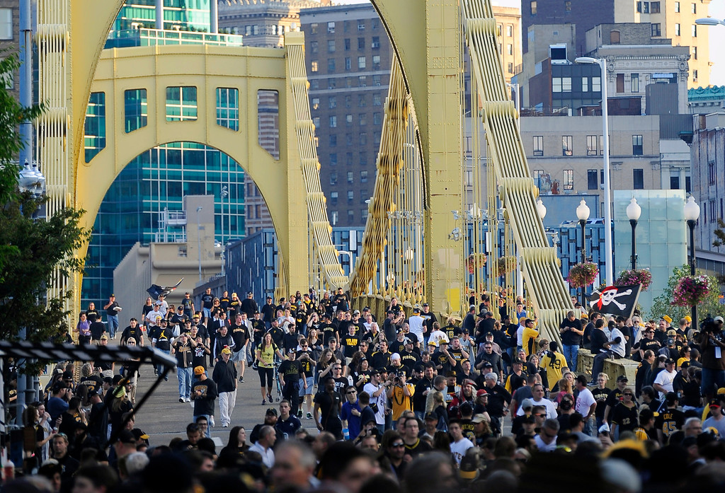 . People cross the Roberto Clemente Bridge on their way to the NL wild-card playoff baseball game between the Pittsburgh Pirates and the Cincinnati Reds on Tuesday, Oct. 1, 2013, in Pittsburgh. The Pirates were making their first post-season appearance since 1992. (AP Photo/Don Wright)