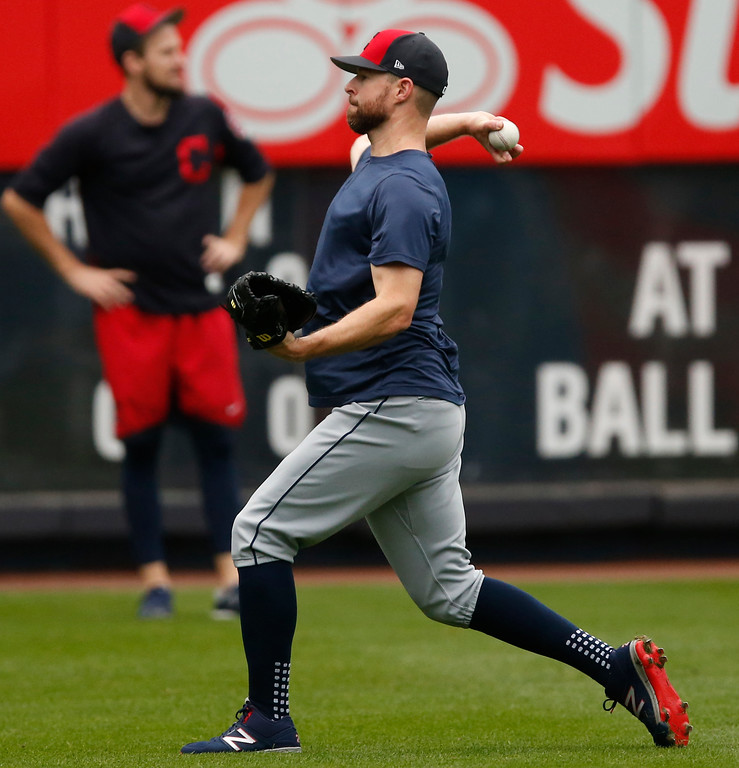 . Cleveland Indians starting pitcher Corey Kluber, right, throws on the field before an American League Division Series baseball game between the New York Yankees and the Cleveland Indians in New York, Monday, Oct. 9, 2017. (AP Photo/Kathy Willens)