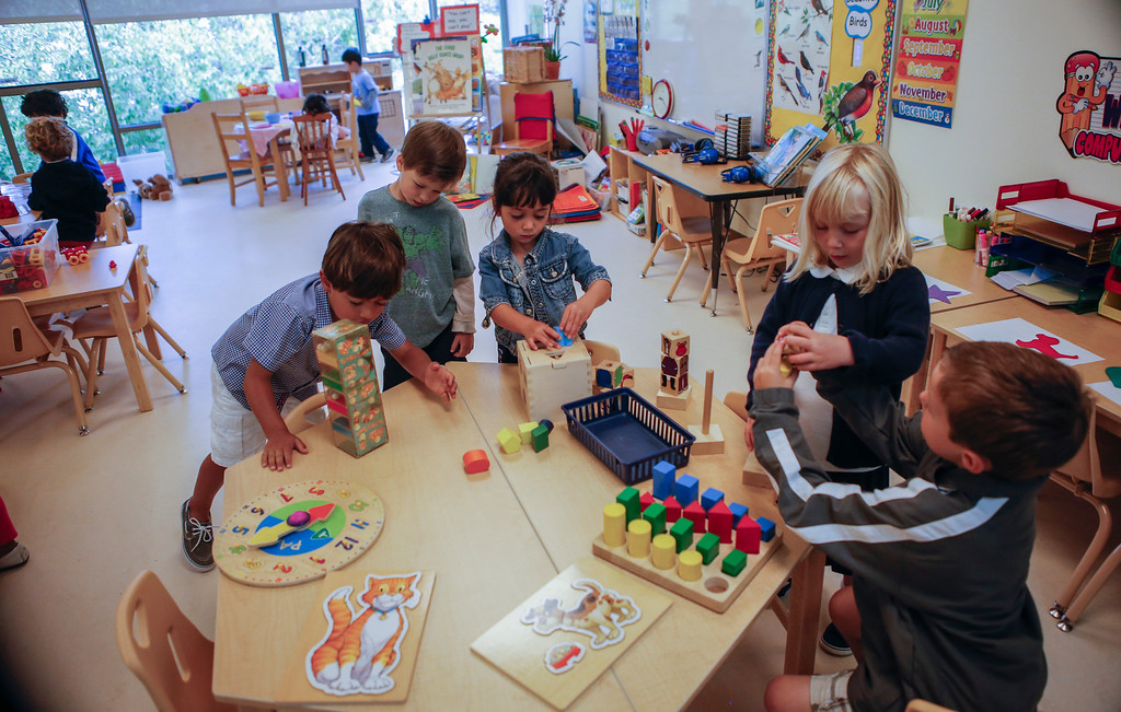 . Pre-kindergarten students play in one of the newly constructed Early Childhood Center classrooms at Charles House in San Mateo, Calif., on Tuesday, Sept. 10,  2013. (John Green/Bay Area News Group)(THE SHOOL DID NOT WANT KIDS NAMES USED)