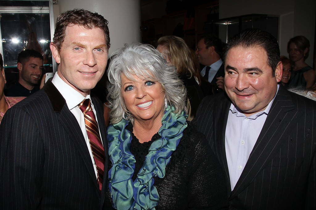 . In this photo provided by StarPix, from left to right, chefs Bobby Flay, Paula Deen, and Emeril Lagasse from the Food Network attend the unveiling of Barneys New York food themed holiday windows, Tuesday, Nov. 16, 2010 in New York.  (AP Photo/Marion Curtis, StarPix)