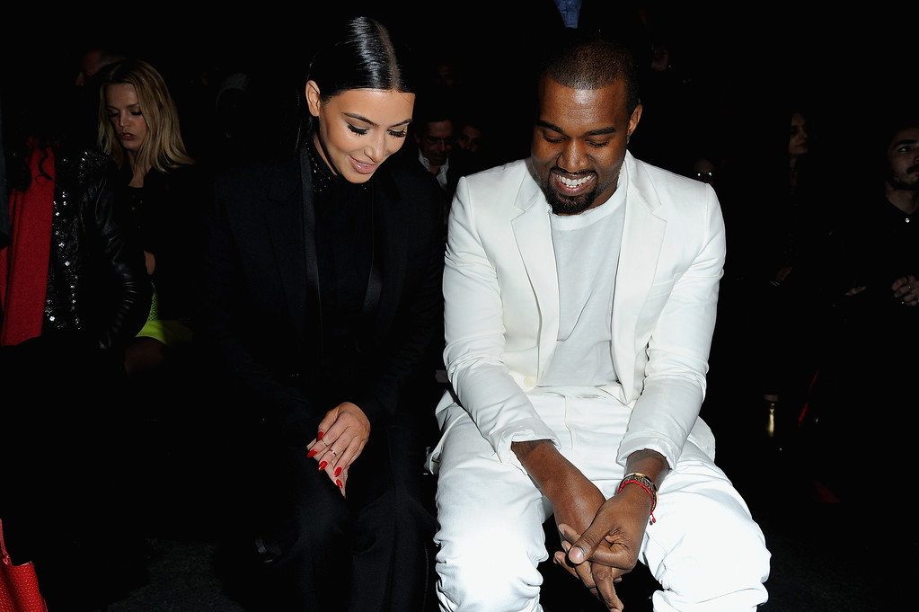 . PARIS, FRANCE - MARCH 03:  Kim Kardashian and Kanye West attend Givenchy  Fall/Winter 2013 Ready-to-Wear show as part of Paris Fashion Week on March 3, 2013 in Paris, France.  (Photo by Pascal Le Segretain/Getty Images)