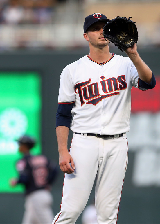 . Minnesota Twins pitcher Jake Odorizzi waits for a ball as Cleveland Indians\' Francisco Lindor, left, rounds the bases on a three-run home run during the fourth inning of a baseball game Thursday, May 31, 2018, in Minneapolis. (AP Photo/Jim Mone)