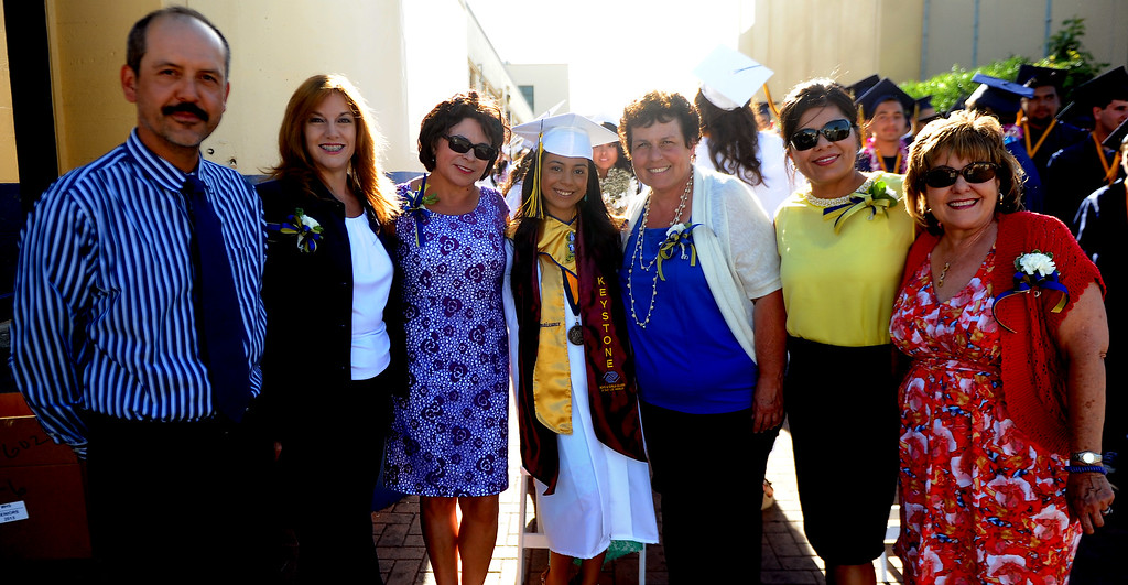 . Student Emma Islas poses for a picture with her teachers during the Montebello High School commencement at Montebello High School on Thursday, June 20, 2013 in Montebello, Calif.  (Keith Birmingham/Pasadena Star-News)