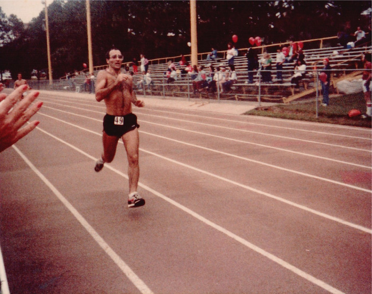 This next sequence is on the FSU track. Note the pre-Rekortan surface. I believe the race is the 1982 Chenoweth 15K. Looks like Gordon Cherr finishing.