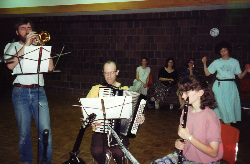An older photo!  June 18, 1993.    [Searching in 2013 though my old photo albums, this was the earliest photo I found of the band. Gene Goldwater started learning accordion in order to play for the AIFD dances. Ken and I moved to the area in summer 1992 and began dancing there. We asked if we (with trumpet and tupan) could play with Gene. Soon his daughter Sharon joined with clarinet. Eva, leading the dance here, also briefly played clarinet with us.  ]