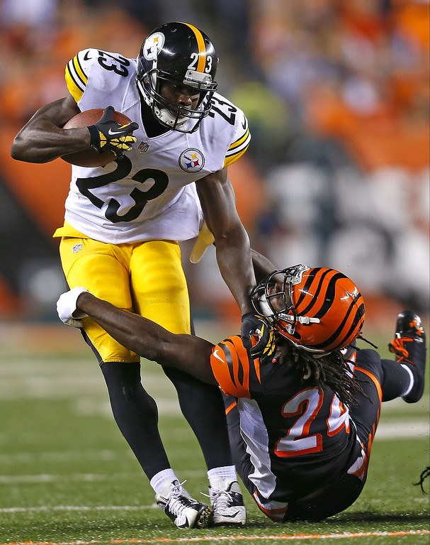 . Felix Jones #23 of the Pittsburgh Steelers is tackled by Adam Jones #24 of the Cincinnati Bengals during the first quarter on September 16, 2013 at Paul Brown Stadium on September 16, 2013 in Cincinnati, Ohio. (Photo by Kirk Irwin/Getty Images)