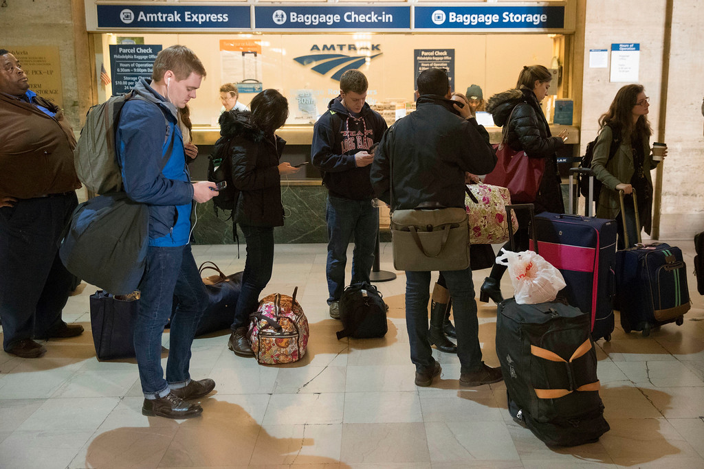 . Travelers stand in line to board a train at the 30th Street Station ahead of the Thanksgiving Day holiday, in Philadelphia, Tuesday, Nov. 22, 2016. Almost 49 million people are expected to travel 50 miles or more for the holiday, the most since 2007, according to AAA. (AP Photo/Matt Rourke)